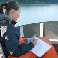 Researcher taking notes during a whale survey